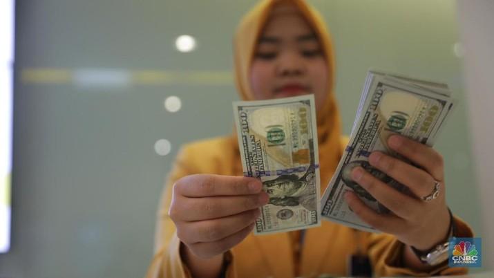 Kenaikan Bunga Acuan 50 Bps untuk Pancing Hot Money