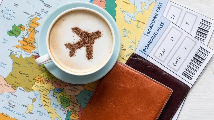 Europe map and airplane in cappuccino (made of cinnamon). Travel concept. Travel agency