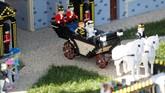 Pangeran Harry dan Meghan Markle sudah mengenakan busana pernikahan mereka di Windsor Castle. Mereka bahkan sudah menaiki 'kereta kencana' yang ditarik dengan kuda. (REUTERS/Peter Nicholls)