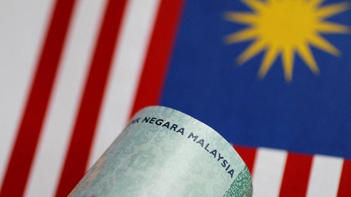FILE PHOTO: A Malaysia Ringgit note is seen in this illustration photo June 1, 2017.     REUTERS/Thomas White/Illustration/File Photo