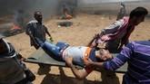 Akibatnya, lebih dari 50 warga Palestina tewas dan banyak lainnya luka-luka, sementara tak ada korban jatuh dari pihak Israel.(REUTERS/Ibraheem Abu Mustafa)