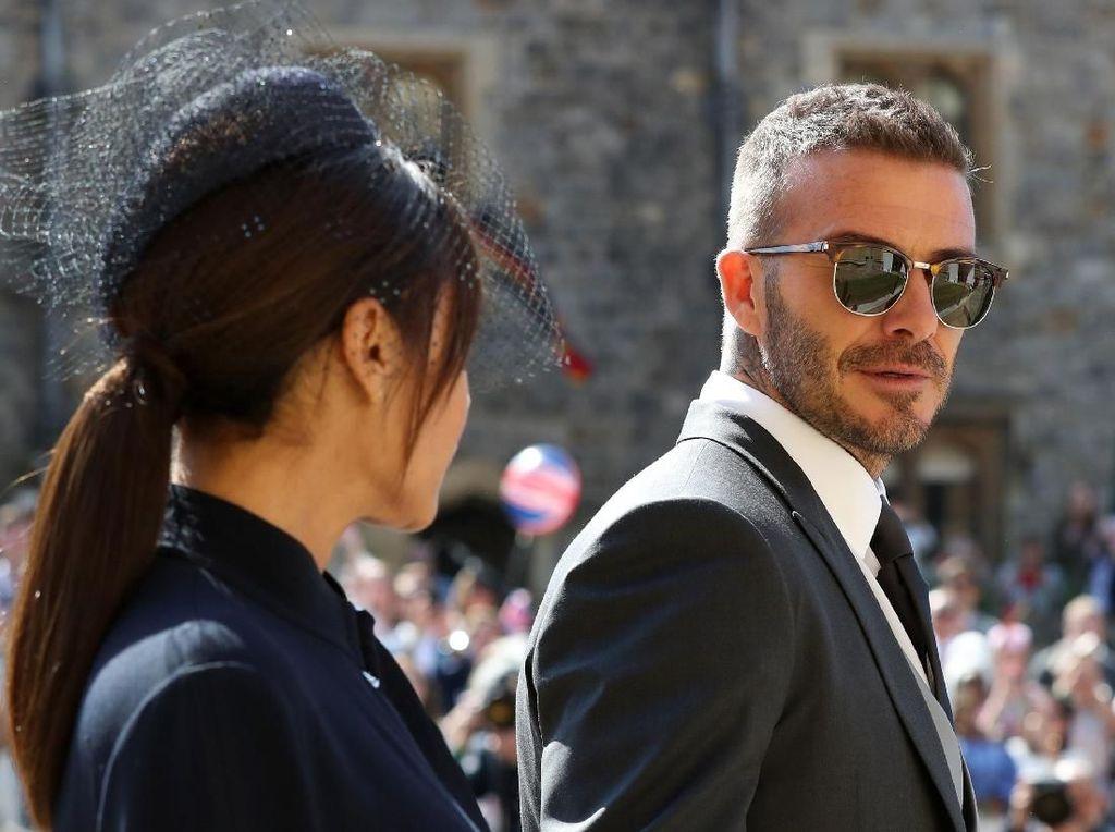 Spotted! David dan Victoria Beckham Modis di Pernikahan Pangeran Harry