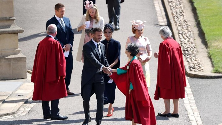 David and Victoria Beckham arrive for the wedding of Prince Harry and Meghan Markle at Windsor Castle in Windsor, Britain, May 19, 2018. Andrew Matthews/Pool via REUTERS