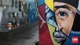Banyak objek yang menjadi inspirasi warga dalam membuat mural, namun biasanya mereka mengambil tema-tema dalam kehidupan sehari-hari. (CNN Indonesia/Andry Novelino)