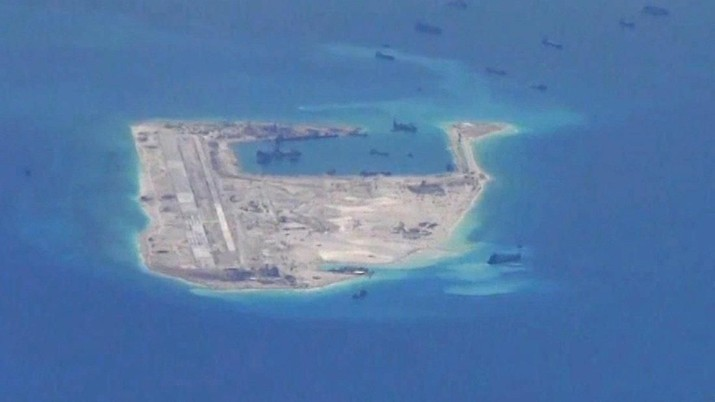 FILE PHOTO: Chinese dredging vessels are purportedly seen in the waters around Fiery Cross Reef in the disputed Spratly Islands in the South China Sea in this still image from video taken by a P-8A Poseidon surveillance aircraft provided by the United States Navy May 21, 2015. U.S. Navy/Handout via Reuters/File Photo ATTENTION EDITORS - THIS PICTURE WAS PROVIDED BY A THIRD PARTY. EDITORIAL USE ONLY