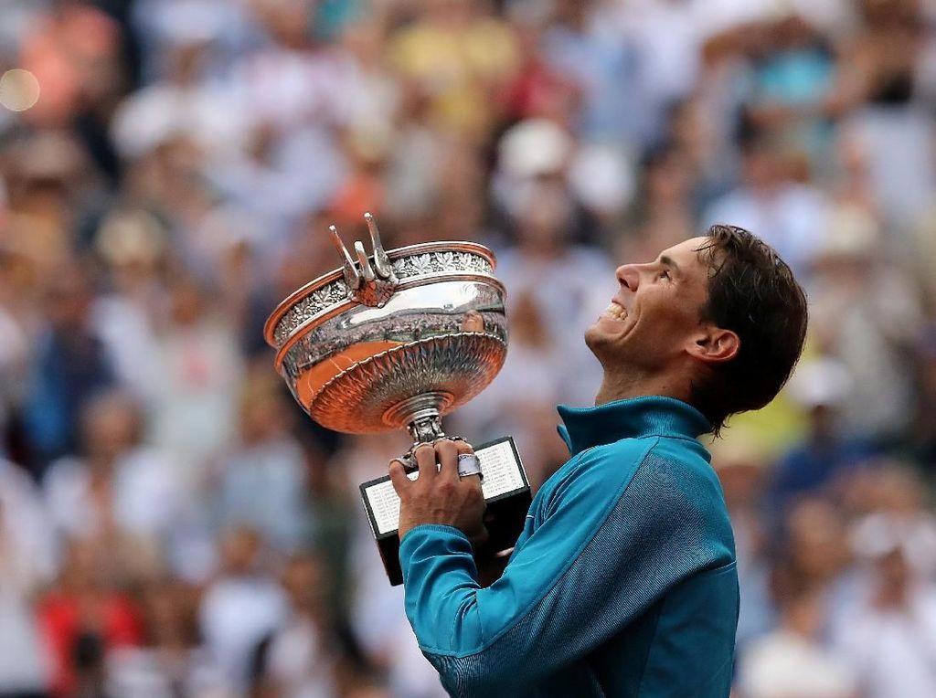 Gelar ini melengkapi sukses Nadal di turnamen tanah liat pada 2018. Pada April lalu, Nadal sukses merengkuh titel juara Monte Carlo dan Barcelona Terbuka juga untuk kesebelas kalinya, sementara di Roma Masters ia juara untuk kedelapan kali.Madrid Masters jadi satu-satunya turnamen yang gagal dijuarai Nadal usai dikalahkan Thiem di perempatfinal. (Foto: Pascal Rossignol/Reuters)