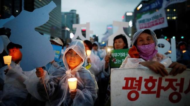 Pertemuan ini membawa harapan perdamaian Korut dan Korsel, penghentian pengembangan senjata nuklir dan perbaikan hubungan dengan Amerika Serikat. (REUTERS/Kim Hong-Ji)