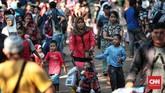 Ragunan masih menjadi salah satu tujuan wisata favorit pada libur Idul Fitri 2018. Pada hari ketiga Lebaran, Minggu (17/6), saja Ragunan diserbu 151 ribu pengunjung. (CNN Indonesia/Andry Novelino)