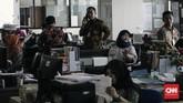 Namun, jumlah keterlambatan dan ketidakhadiran ini diklaim sudah menurun sekitar sepuluh persen dari tahun-tahun sebelumnya. (CNN Indonesia/Adhi Wicaksono)