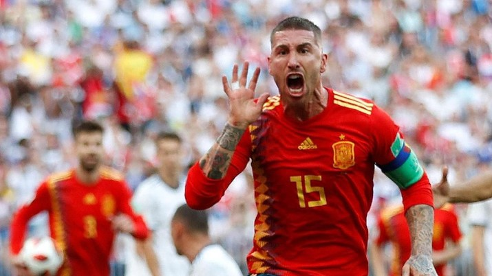 Soccer Football - World Cup - Round of 16 - Spain vs Russia - Luzhniki Stadium, Moscow, Russia - July 1, 2018  Spain's Sergio Ramos celebrates after Russia's Sergei Ignashevich scored an own goal and the first goal for Spain  REUTERS/Carl Recine