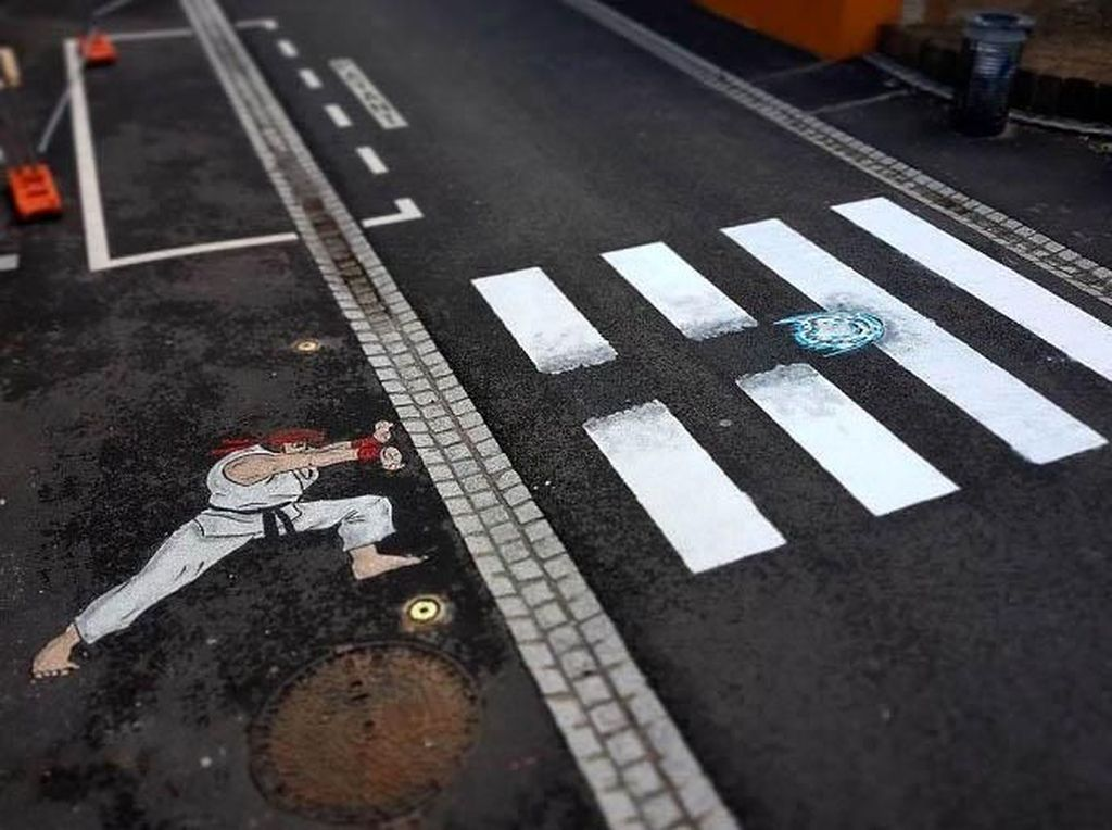 Ia memanfaatkan zebra cross untuk menciptakan karya seni baru. Istimewa/Boredpanda/Instagram/Oakoak Street Art.