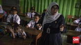 Suasana di kelas pada hari pertama sekolah di SDN Kampung Melayu 01/02, Jatinegara, Jakarta Timur. (CNNIndonesia/Adhi Wicaksono).