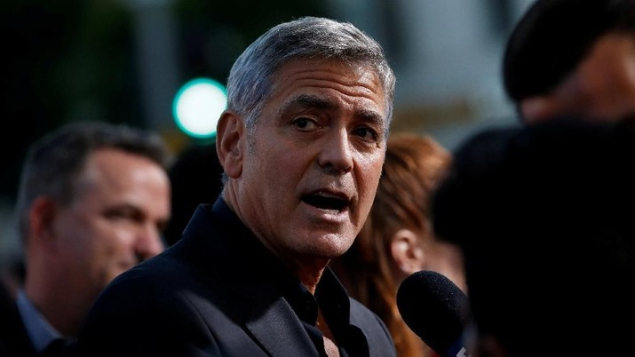 FILE PHOTO: Director George Clooney is interviewed at the premiere for