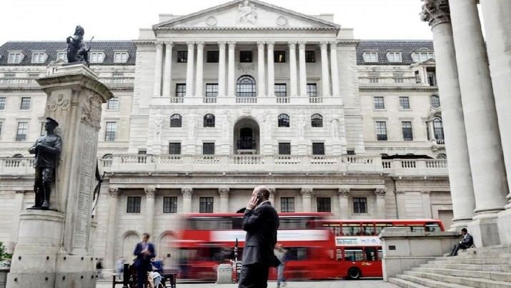 FILE PHOTO - A man talks on a mobile phone as people walk past the Bank of England, in London, Britain September 21, 2017. REUTERS/Mary Turner