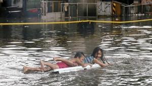 FOTO: Hujan Tropis dan Banjir Landa Manila
