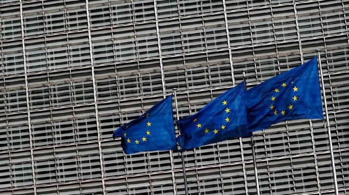 European Union flags flutter outside the EU Commission headquarters in Brussels, Belgium, March 12, 2018. REUTERS/Yves Herman