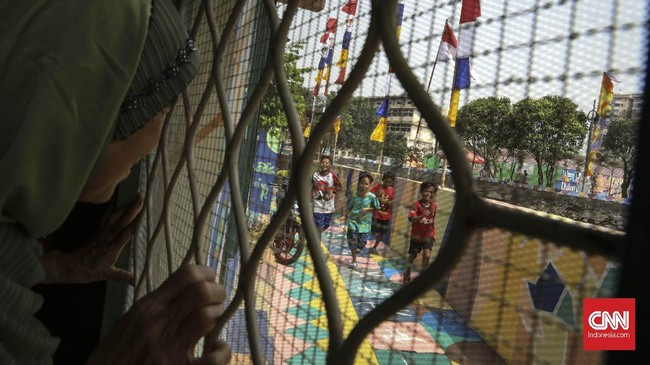 Gubernur DKI Jakarta Anies Baswedan berharap warga Kampung Delta juga antusias menyambut para atlet yang akan berdatangan di Wisma Atlet Kemayoran. (CNN Indonesia/ Hesti Rika)
