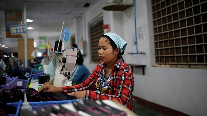 Khen Srey Touch, 27, who is nine months pregnant, sews shoes at work at Complete Honour Footwear Industrial, a footwear factory owned by a Taiwan company, in Kampong Speu, Cambodia, July 5, 2018. Khen Srey Touch works 10 hours a day, six days a week and earns $240 a month.
