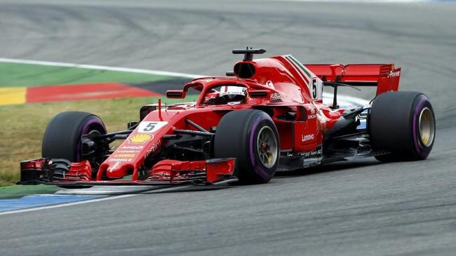Pebalap Ferrari Sebastian Vettel sukses merebut pole GP Jerman dengan catatan waktu 1 menit 11,212 detik. (REUTERS/Ralph Orlowski)
