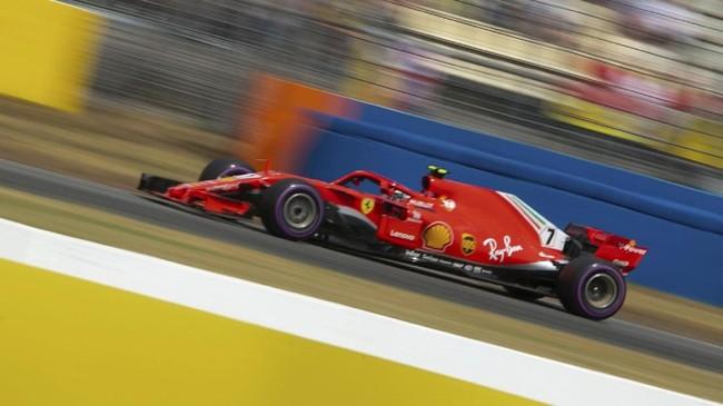 Rekan setim Sebastian Vettel di Ferrari, Kimi Raikkonen, berhasil merebut posisi ketiga pada babak kualifikasi GP Jerman. (REUTERS/Wolfgang Rattay)