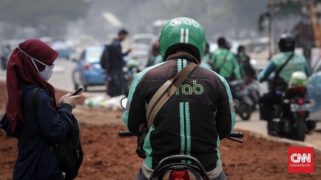 Grab Kritik Penurunan Tarif Gojek
