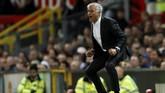 Jose Mourinho berhasil mewujudkan ambisinya memulai Liga Inggris dengan raihan tiga poin. (Reuters/Andrew Boyers)
