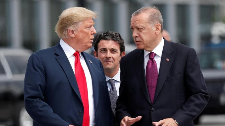 FILE PHOTO: U.S. President Donald Trump and Turkish President Tayyip Erdogan gesture as they talk at the start of the NATO summit in Brussels, Belgium July 11, 2018.  REUTERS/Kevin Lamarque/File Photo