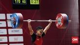 Lifter Indonesia Eko Yuli Irawan terlihat senang setelah herhasil melakukan angkatan clean and jerk seberat 170 kilogram. (CNNIndonesia/Safir Makki)