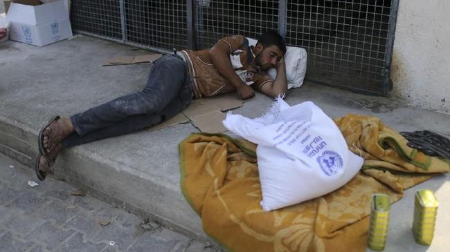 AS memutuskan menghentikan seluruh pendanaan bagi UNRWA, badan PBB yang membantu jutaan pengungsi Palestina. (REUTERS/Ibraheem Abu Mustafa)
