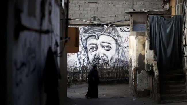 Bagi Palestina langkah ini membuat impian mendirikan negara sendiri semakin jauh untuk diwujudkan. (REUTERS/Mohammed Salem)