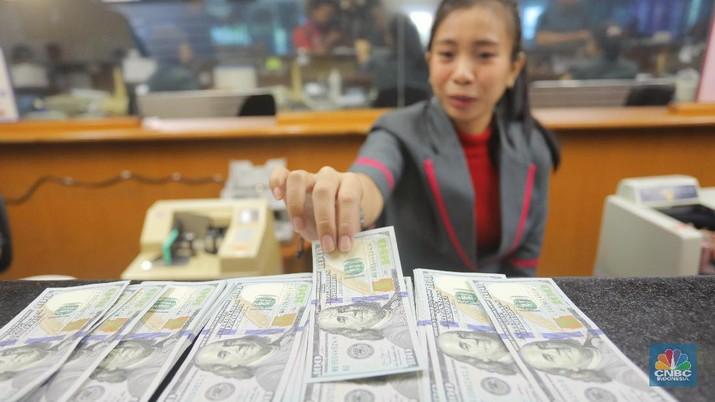 Pukul 12:00 WIB: Rupiah Melemah ke Rp 14.085/US$