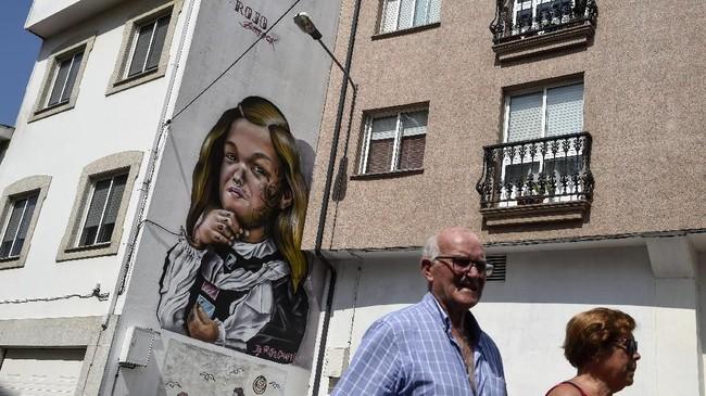 Tercatat, setidaknya sudah ada 240 jenis mural yang terpatri di bangunan kawasan ini dan terinspirasi dari banyak mahakarya maestro dunia. (AFP PHOTO / MIGUEL RIOPA)