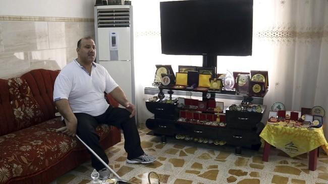 Faris al-Ajeeli termasuk sosok atlet veteran lantaran ia sudah tampil di Paralimpiade 2004. Pada Paralimpiade 2012, ia meraih perak. (AFP PHOTO / Zaid AL-OBEIDI)