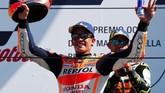 Marc Marquez tetap puas berada di podium kedua di Sirkuit Misano. Ia kokoh di posisi pertama klasemen sementara MotoGP dengan koleksi 221 poin, unggul 67 angka dari Dovizioso yang ada di posisi kedua. (REUTERS/Max Rossi)