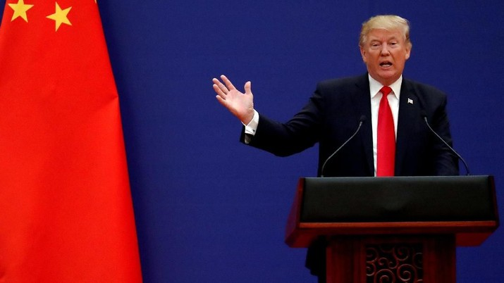 FILE PHOTO: U.S. President Donald Trump delivers his speech as he and China's President Xi Jinping meet business leaders at the Great Hall of the People in Beijing, China, November 9, 2017. REUTERS/Damir Sagolj/File Photo