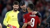 Juergen Klopp memuji Roberto Firmino yang mencetak gol penentu kemenangan Liverpool atas PSG 3-2 pada masa injury time babak kedua. (Reuters/Carl Recine)