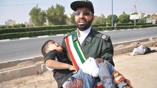 Sementara itu, Presiden Iran, Hassan Rouhani, sendiri menuding Amerika Serikat sebagai otak di balik serangan tersebut. (AFP Photo/ISNA/Behrad Ghasemi)