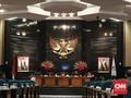 PSI Resmi Pakai Pin Kuningan dari DPRD DKI