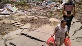 Selain menderita luka fisik, data Kemenkes RI mencatat korban gempa dan tsunami juga menderita trauma.(AFP PHOTO / MUHAMMAD RIFKI)