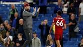 Manajer Liverpool Juergen Klopp memuji kerja keras anak asuhnya yang berhasil meraih satu poin di markas Chelsea. (Reuters/John Sibley)