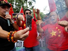 Perang Dagang Memanas, Demonstran China Bakar Apple iPhone