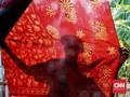 FOTO : Warna 'Berani' Betawi di Hari Batik