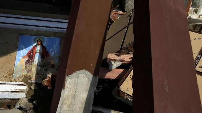 Sejumlah rumah ibadah juga turut hancur karena gempa dan tsunami yang menerjang Sulteng.(REUTERS/Beawiharta)