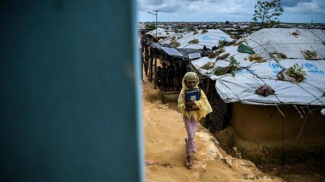 Saleema Khanam adalah salah satu anak yang ikut madrasah tersebut (AFP PHOTO / CHANDAN KHANNA)