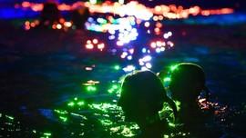 FOTO: Melawan Kerusakan Terumbu Karang Lewat Seni Cahaya