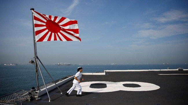 Yuma Osaki, a navigator, prepares to blow a bugle on the bridge of Japanese helicopter carrier Kaga as it departs for naval drills in the Indian Ocean, Indonesia, September 22, 2018. REUTERS/Kim Kyung-Hoon SEARCH