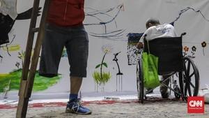 FOTO: Mendobrak Keterbatasan dengan Imajinasi dan Mural