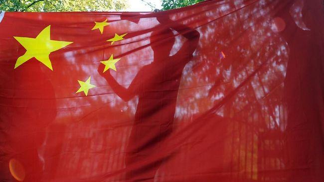 China Marah Logo Bintang di Bendera Diubah Jadi Virus Corona
