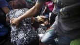 Namun, pemerintah Meksiko melarang para imigran ini memasuki negara mereka atas tekanan dari Washington. (REUTERS/Edgard Garrido)