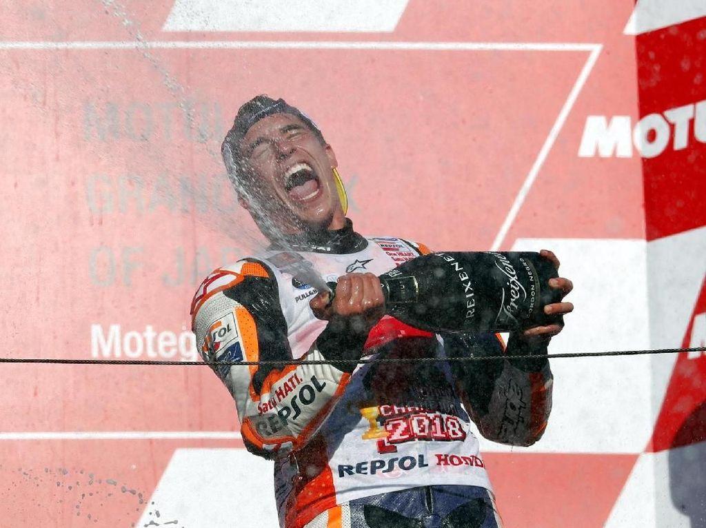 Marquez menjadi juara setelah unggul 102 poin dari rival terdekatnya Dovizoso (194 poin). Dengan tiga balapan tersisa, perolehan angka Marquez tidak akan bisa terkejar. Reuters/Toru Hanai.